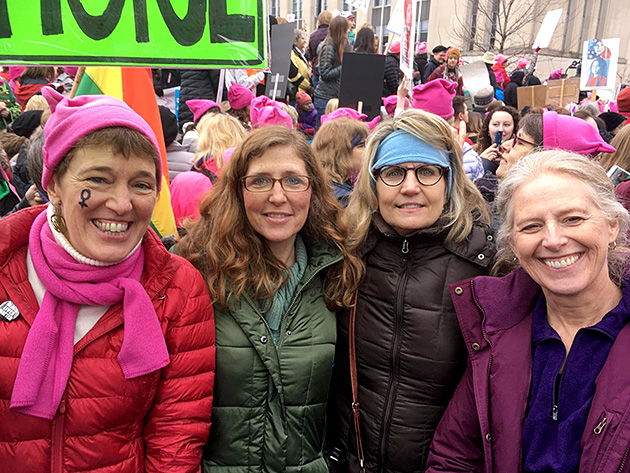photo of four women at a women's march