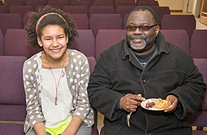 congregational member and his daughter