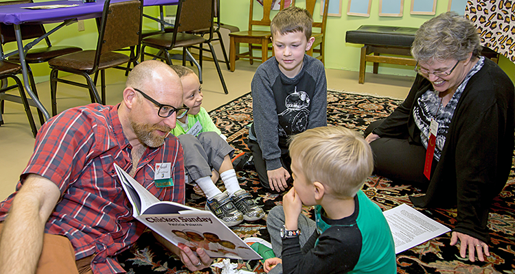 adults reading to children